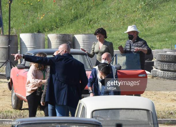 """Lady Gaga is seen filming """"House of Gucci"""" in a red Fiat Spider on April 21, 2021 in Rome, Italy."""