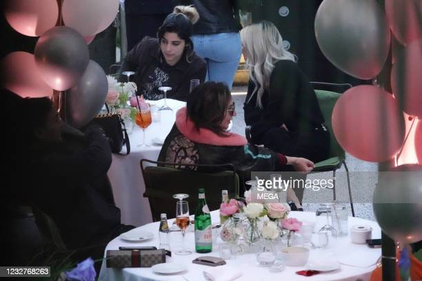 Lady Gaga is seen having a drink with some members of the film crew on May 7, 2021 in Rome, Italy.