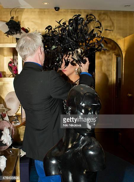 LONDON ENGLAND June 08 Lady Gaga is seen leaving Philip Treacy Hat shop Victoria on June 08 2015 in London England