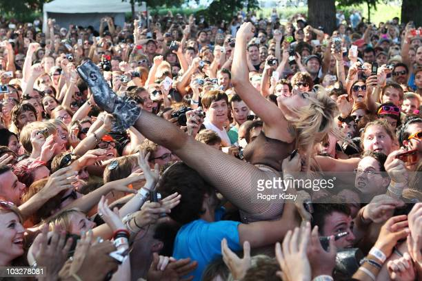 Lady Gaga jumps into the crowd during the performance of Semi Precious Weapons at Lollapalooza at Grant Park on August 6 2010 in Chicago Illinois