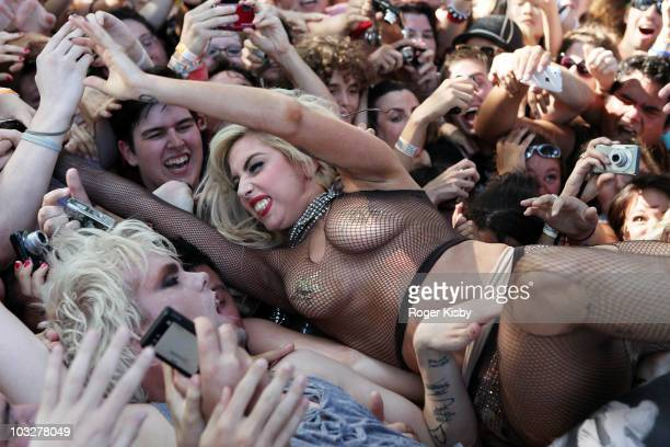 Lady Gaga jumps into the crowd with Justin Tranter of Semi Precious Weapons at Lollapalooza at Grant Park on August 6 2010 in Chicago Illinois
