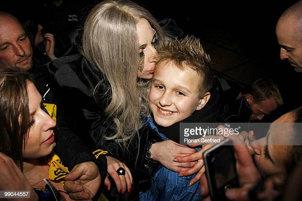 Lady Gaga kisses a fan during she leaves the O2 World after her concert on May 11 2010 in Berlin Germany