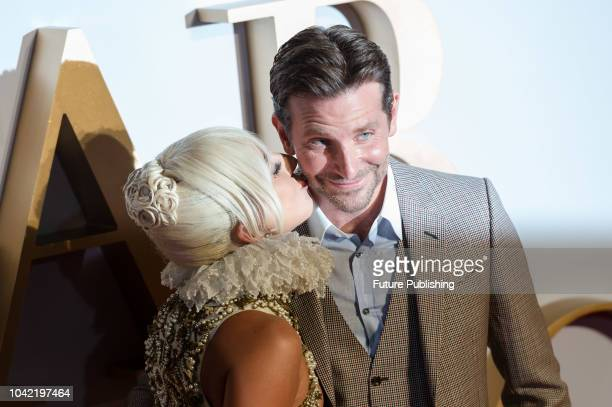 Lady Gaga kisses Bradley Cooper on the cheek at the UK film premiere of 'A Star Is Born' at Vue West End in London September 27 2018 in London United...