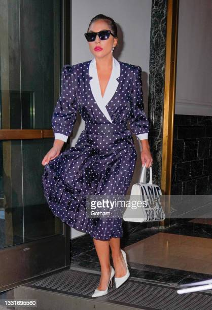 Lady Gaga leaves her hotel wearing a polka dot dress on July 31, 2021 in New York City.