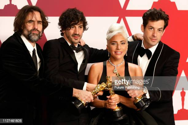 Lady Gaga Mark Ronson Anthony Rossomando Andrew Wyatt pose in the press room at the 91st Annual Academy Awards at the Dolby Theatre in Hollywood...