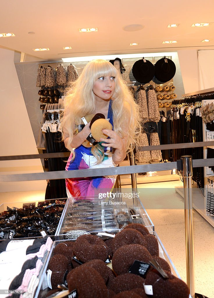 Lady Gaga opens an epic H&M store in Times Square on November 13, 2013 in New York City.