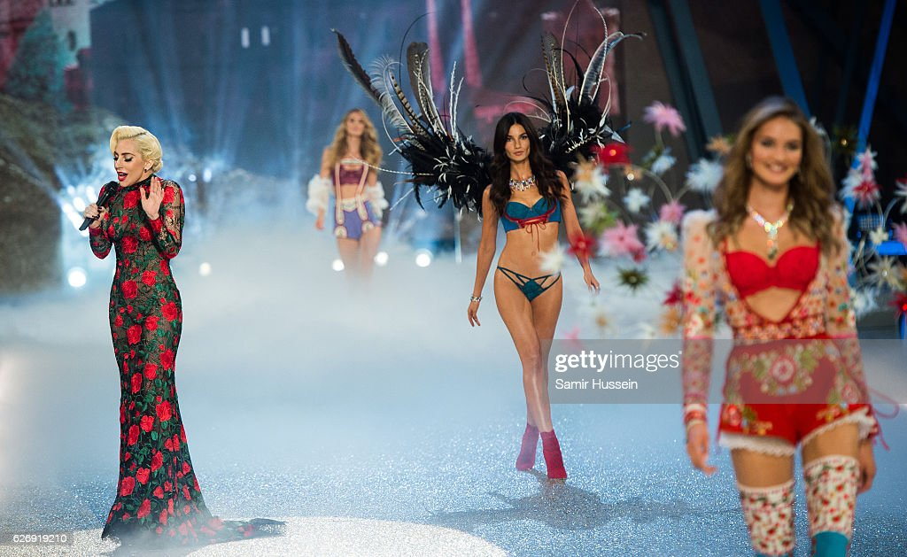Lady Gaga performs as Lily Aldridge walks the runway during the annual Victoria's Secret fashion show at Grand Palais on November 30, 2016 in Paris, France.