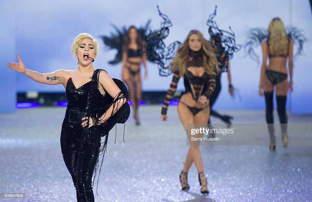 Lady Gaga performs as models walk the runway during the annual Victoria's Secret fashion show at Grand Palais on November 30, 2016 in Paris, France.