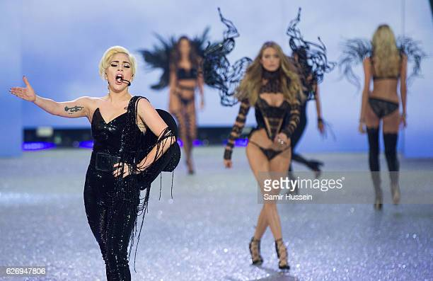 Lady Gaga performs as models walk the runway during the annual Victoria's Secret fashion show at Grand Palais on November 30 2016 in Paris France