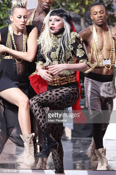 Lady Gaga performs her new song 'Judas' during the 'Le Grand Journal' tv show at Martinez Beach Pier on May 11, 2011 in Cannes, France.
