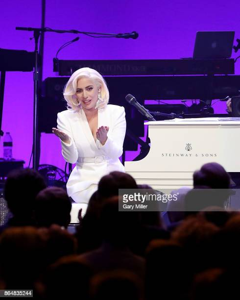Lady Gaga performs in concert as a surprise guest during the Deep From The Heart One America Appeal Concert at Reed Arena on October 21 2017 in...