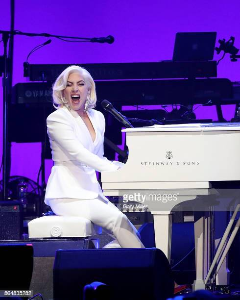 Lady Gaga performs in concert as a surprise guest during the 'Deep From The Heart One America Appeal Concert' at Reed Arena on October 21 2017 in...
