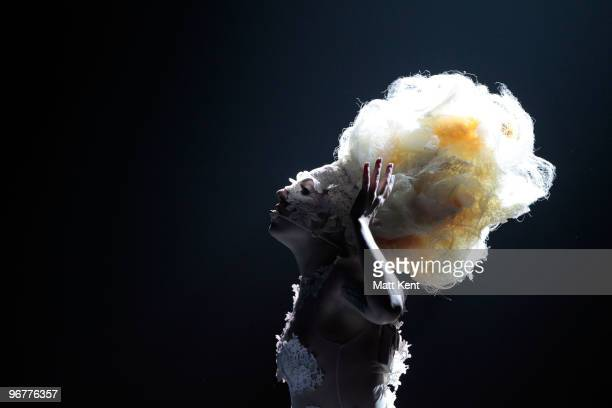 Lady Gaga performs live on stage at The Brit Awards 2010 at Earls Court on February 16 2010 in London England