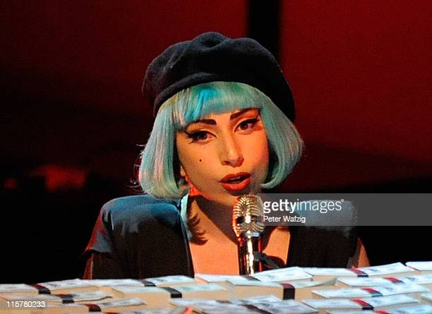 Lady Gaga performs on stage during the finalists show of 'Germany's Next Topmodel' at the LanxessArena on June 09 2011 in Cologne Germany