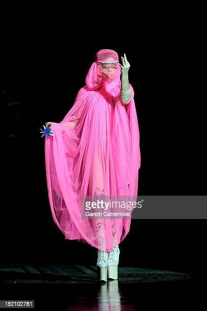 Lady Gaga performs on the catwalk by Philip Treacy on day 3 of London Fashion Week Spring/Summer 2013, at The Royal Courts Of Justice on September...