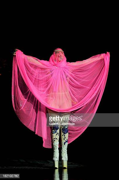 Lady Gaga performs on the catwalk by Philip Treacy on day 3 of London Fashion Week Spring/Summer 2013 at The Royal Courts Of Justice on September 16...