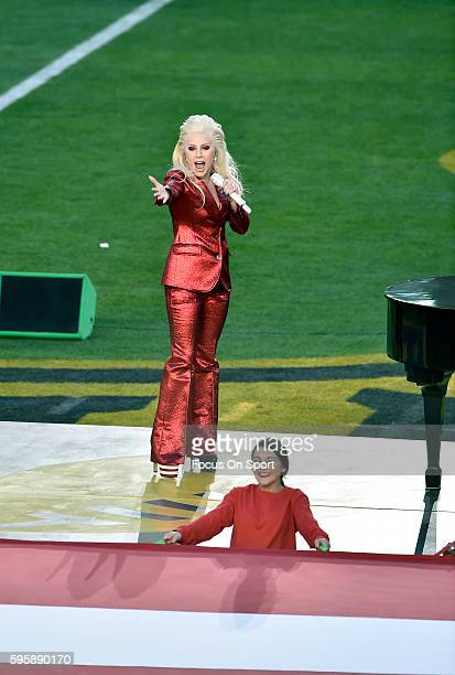 Lady Gaga performs the National Antem during Super Bowl 50 at Levi's Stadium on February 7 2016 in Santa Clara California