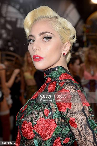 Lady Gaga poses backstage during the Victoria's Secret Fashion Show on November 30 2016 in Paris France