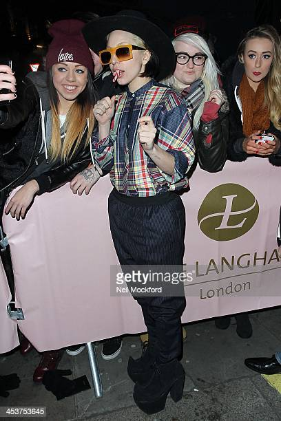 Lady Gaga poses for a photograph with fans as she returns to the Langham hotel on December 5, 2013 in London, England.