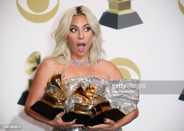 Lady Gaga poses in the press room with her awards for Best Song Written for Visual Media for 'Shallow' Best Pop Duo Group Performance with Bradley...