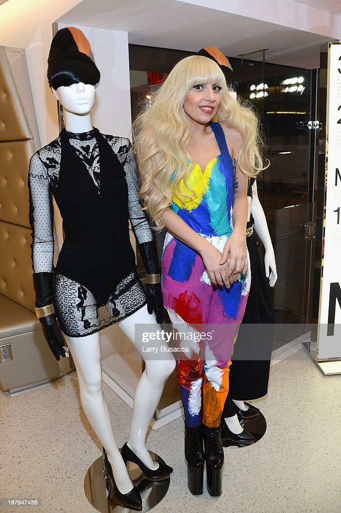 Lady Gaga poses inside the newly opened H&M store in Times Square on November 13, 2013 in New York City.