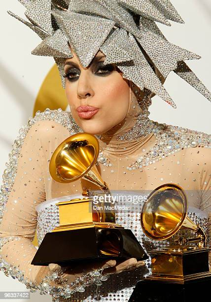 Lady Gaga poses with her awards in the press room at the 52nd Annual GRAMMY Awards held at Staples Center on January 31 2010 in Los Angeles California