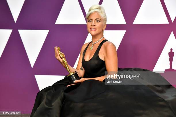 Lady Gaga poses with the Best Original Song award for Shallow in the press room during at Hollywood and Highland on February 24 2019 in Hollywood...