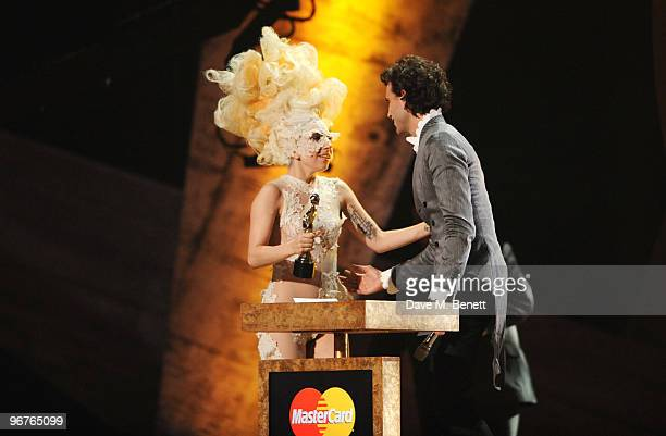 Lady Gaga receives the International Album Award for The Fame presented by Mika on stage during The Brit Awards 2010 at Earls Court One on February...
