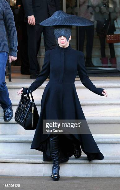 Lady Gaga seen leaving her london hotel wearing a black face mask and head piece sighting on October 30 2013 in London England