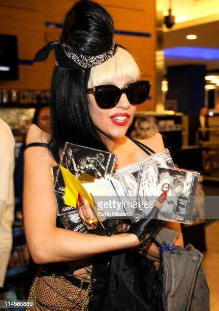 Lady Gaga signs copies of her album Born This Way at Best Buy on May 23 2011 in New York City