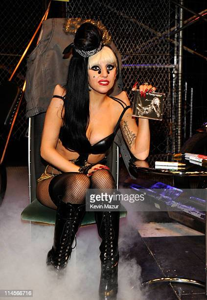 """Lady Gaga signs copies of her album """"Born This Way"""" at Best Buy on May 23, 2011 in New York City."""