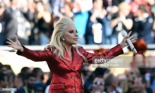 Lady Gaga sings the American National Anthem prior to the start of Super Bowl 50 between the Carolina Panthers and the Denver Broncos at Levi's...