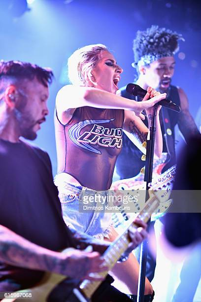 Lady Gaga surprises fans while on the Bud Light x Lady Gaga Dive Bar Tour where the singer performed three new tracks off her upcoming album 'Joanne'...