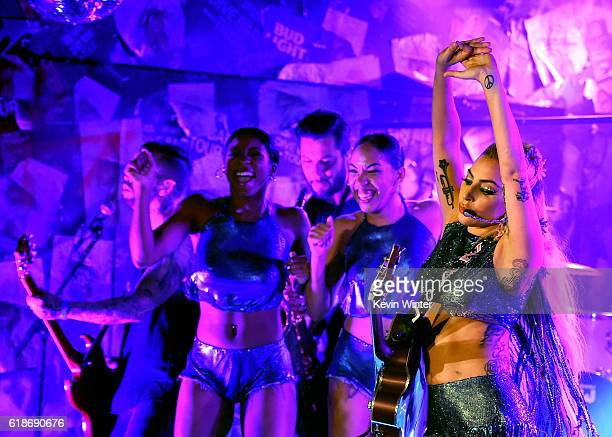 Lady Gaga surprises fans while on the Bud Light x Lady Gaga Dive Bar Tour where the singer performed tracks off her upcoming album 'Joanne' on...