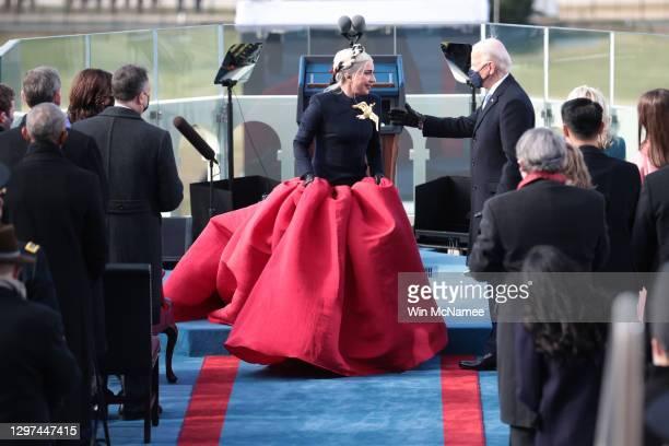 Lady Gaga talks with U.S. President-elect Joe Biden during the inauguration of U.S. President-elect Joe Biden on the West Front of the U.S. Capitol...