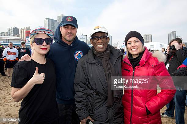 Lady Gaga Taylor Kinney Al Roker Dylan Dreyer take part in the 16th Annual Polar Plunge at North Avenue Beach on March 6 2016 in Chicago Illinois