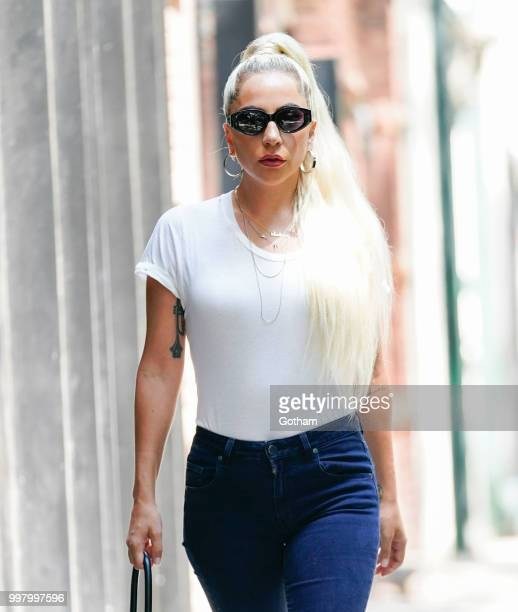 Lady Gaga wears a white T-Shirt and Jeans on July 13, 2018 in New York City.