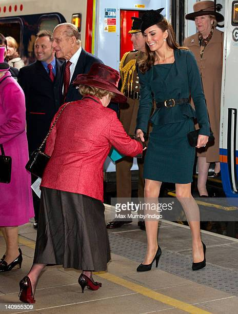 Lady Gretton curtseys to Catherine Duchess of Cambridge as The Duchess Queen Elizabeth II and Prince Philip Duke of Edinburgh arrive at Leicester...