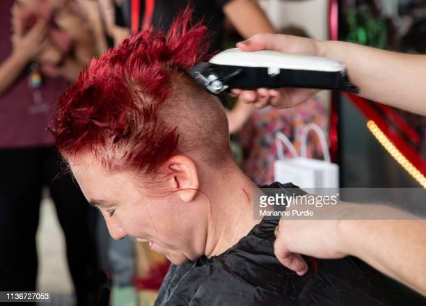 A lady having her head shaved