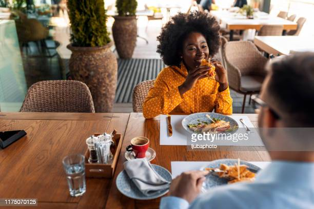 lady having lunch in small family restaurant - restaurant stock pictures, royalty-free photos & images