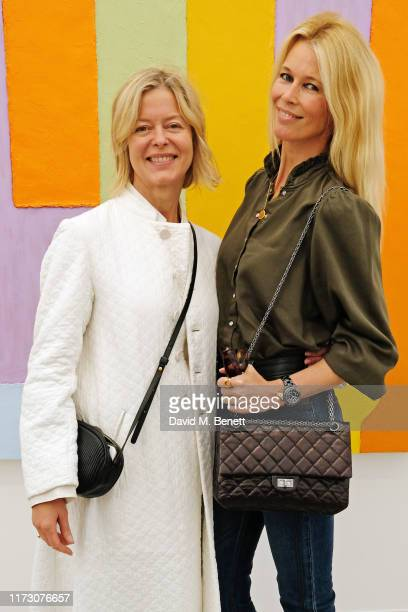 Lady Helen Taylor and Claudia Schiffer attend the Frieze Art Fair VIP Preview in Regent's Park on October 2, 2019 in London, England.