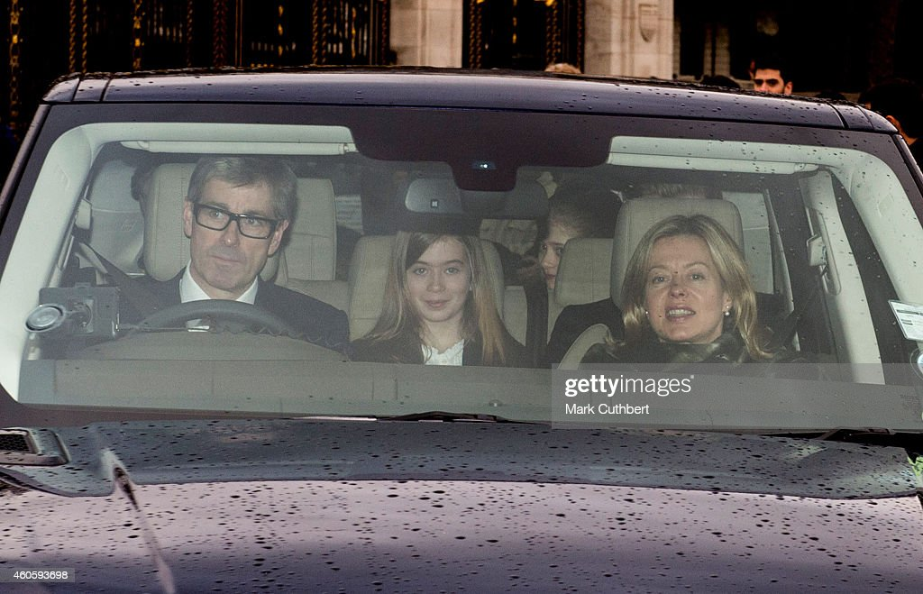 Lady Helen Taylor and Tim Taylor with Eloise Taylor attend a Christmas Lunch at Buckingham Palace on December 17, 2014 in London, England.