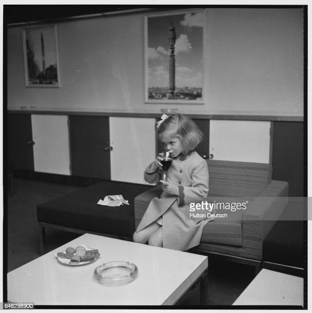 Lady Helen the daughter of the Duke and Duchess of Kent has a soft drink while she waits at the Post Office Tower for the arrival of her uncle Prince...
