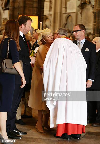 Lady Helen Wogan the widow of Sir Terry Wogan and their children Katerine Alan and Mark talk with the Very Reverend John Hall Dean of Westminster...
