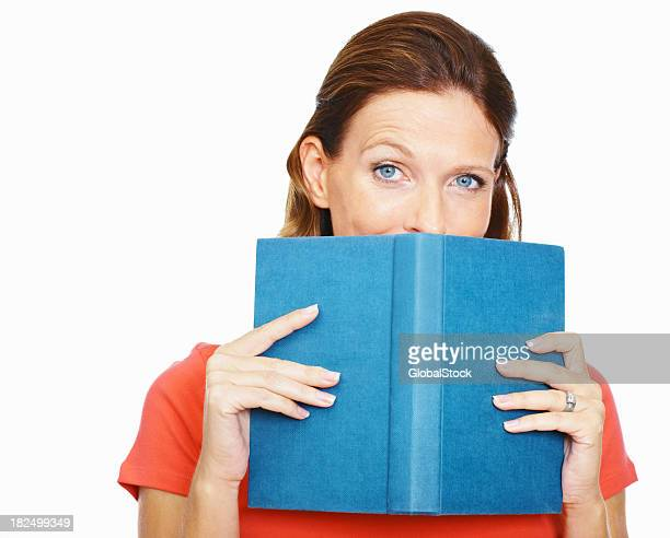 lady hiding behind a book isolated on white background - mid adult stock pictures, royalty-free photos & images