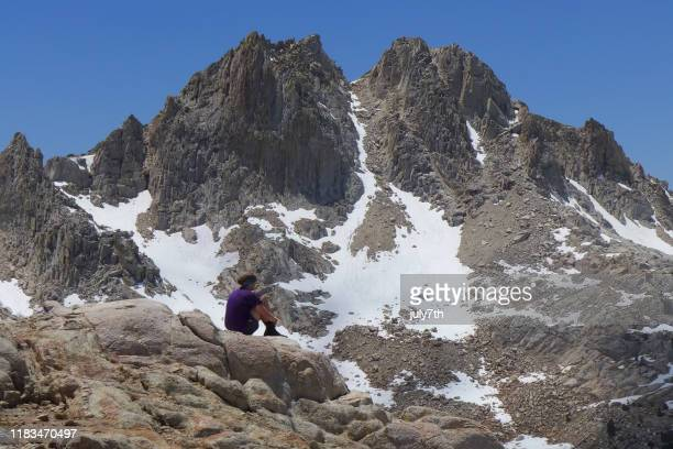 lady hiker looking over the view on silver pass, john muir trail - pacific crest trail stock pictures, royalty-free photos & images
