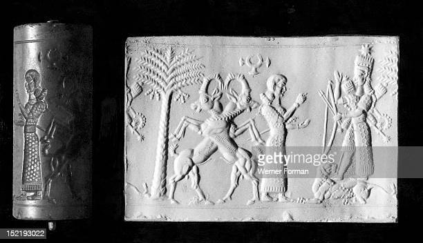 A lady holding a mace worships the goddess Ishtar in the goddess of war aspect She is armed with bow and arrows quiver mace and other weapons and is...
