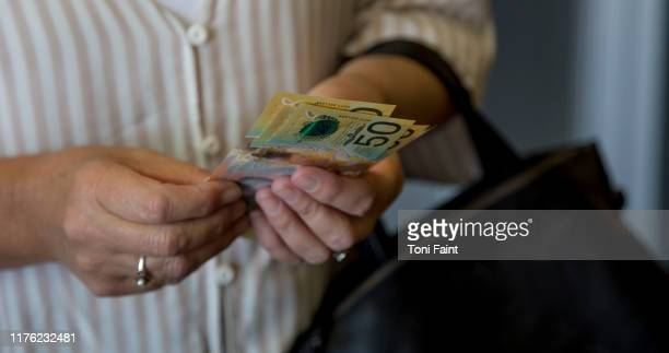 a lady holding australian currency - banknote stock pictures, royalty-free photos & images