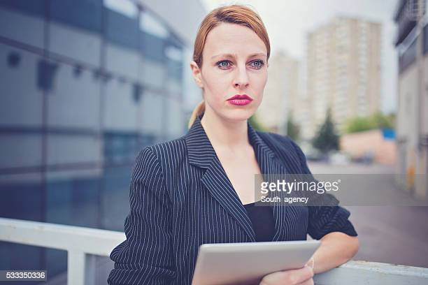 Lady holding Tablet