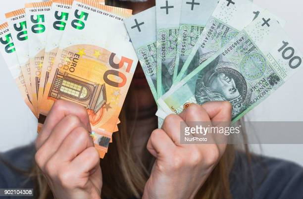 A lady holds notes of 100 Polish Zloty and 50 euro The Polish Zloty was the worlds second topperforming currency in 2017 and gained more than 5...